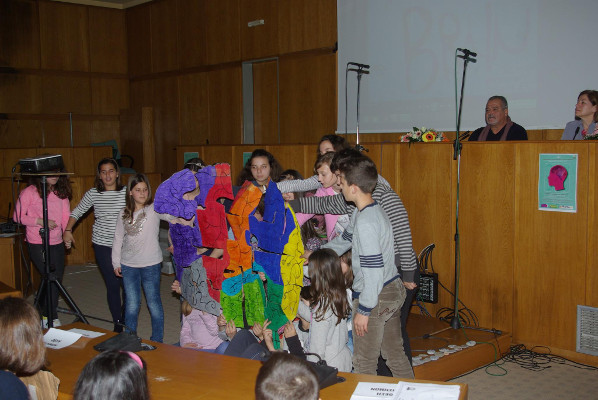6th Primary School of Pyrgos students hold up a hand-made brain puzzle. Greece