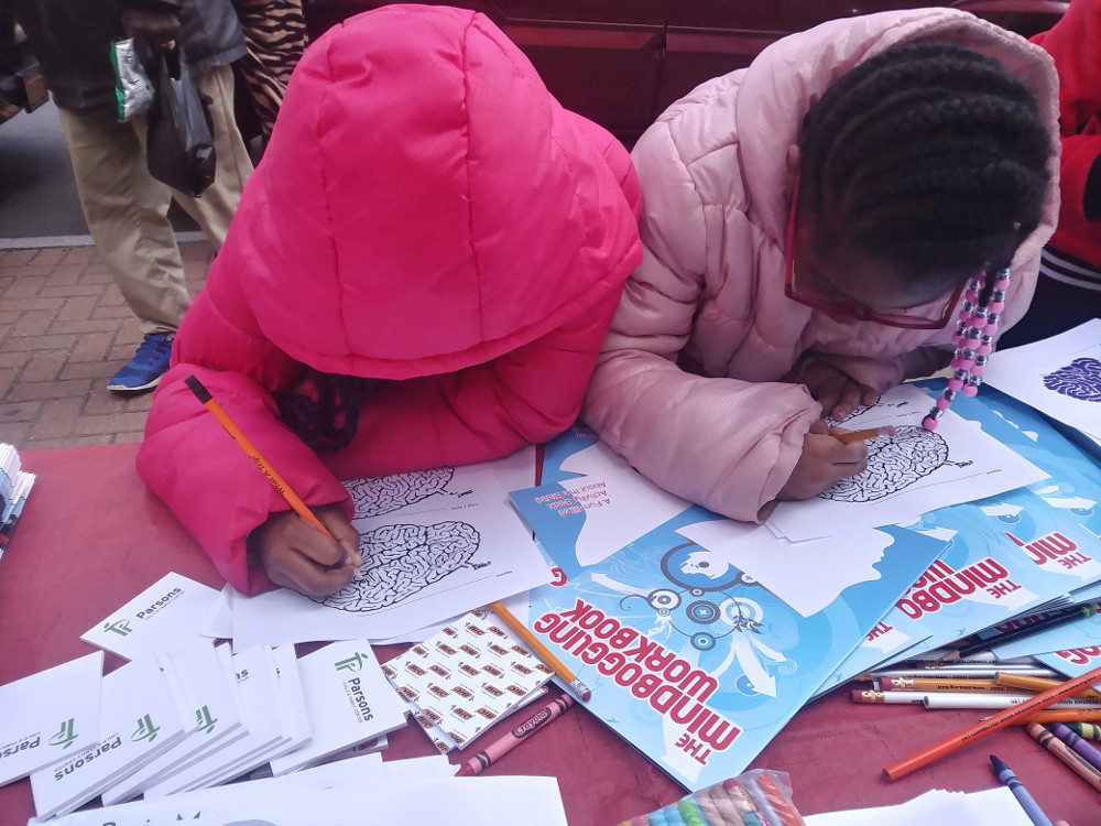 Children color brains at the Family Awareness Day organized by Abram Lansing Parents Teacher Organization.