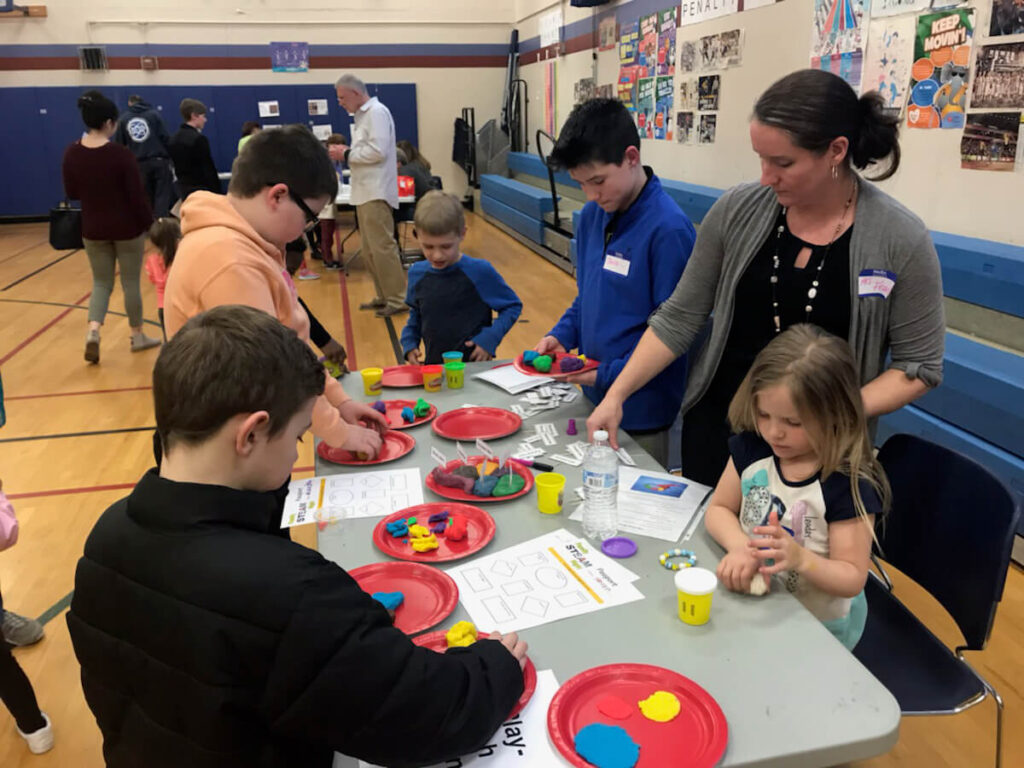 Children make Play-dough brain models during Family STEAM Night organized by Abram Lansing Parents Teacher Organization in Cohoes, New York.