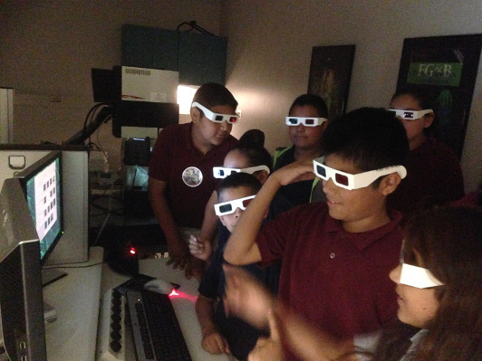 Children at Arizona State University wear 3D goggles during an experiment