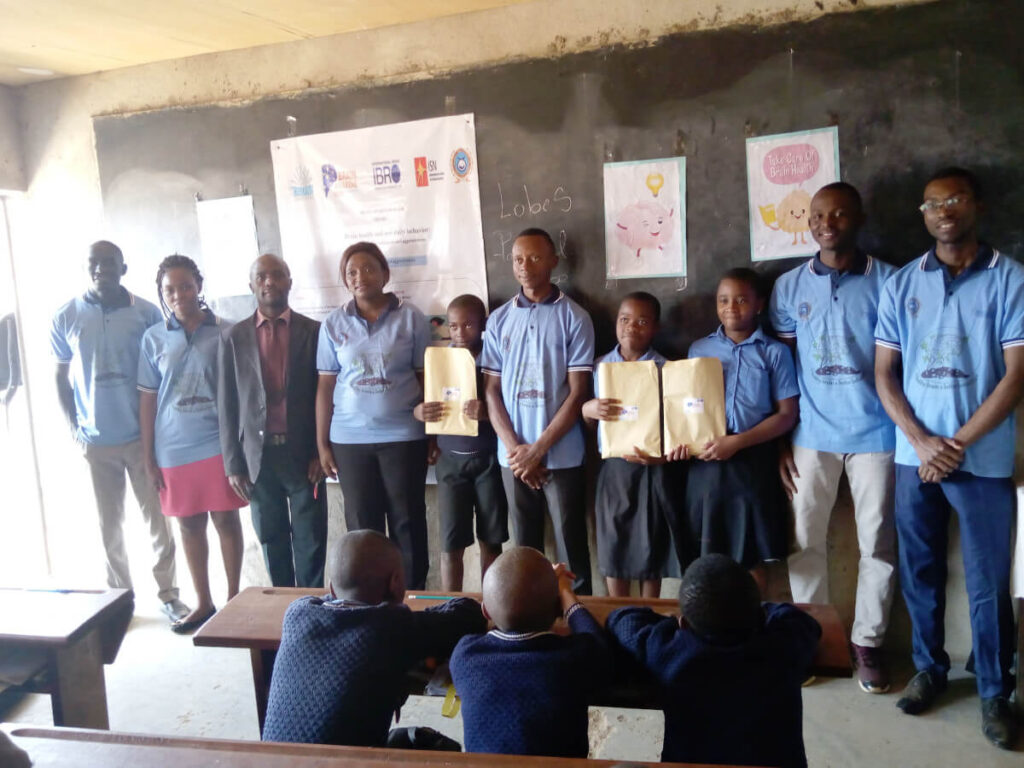 Primary school students receive awards as part of an activity organized by the Cameroon Association for Neuroscience (CAMANE) in Cameroon.