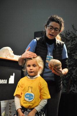 A junior scientist helps with a presentation on the brain organized by Basque Center on Cognition, Brain and Language (BCBL), Spain