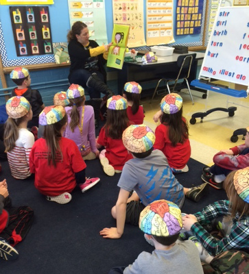 Students wear brain caps during a school visit by the BioScience Project in Wakefield, MA
