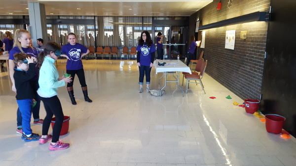 Children participate in an activity during B.R.A.I.N Day organized by Boston University's Mind and Brain Society