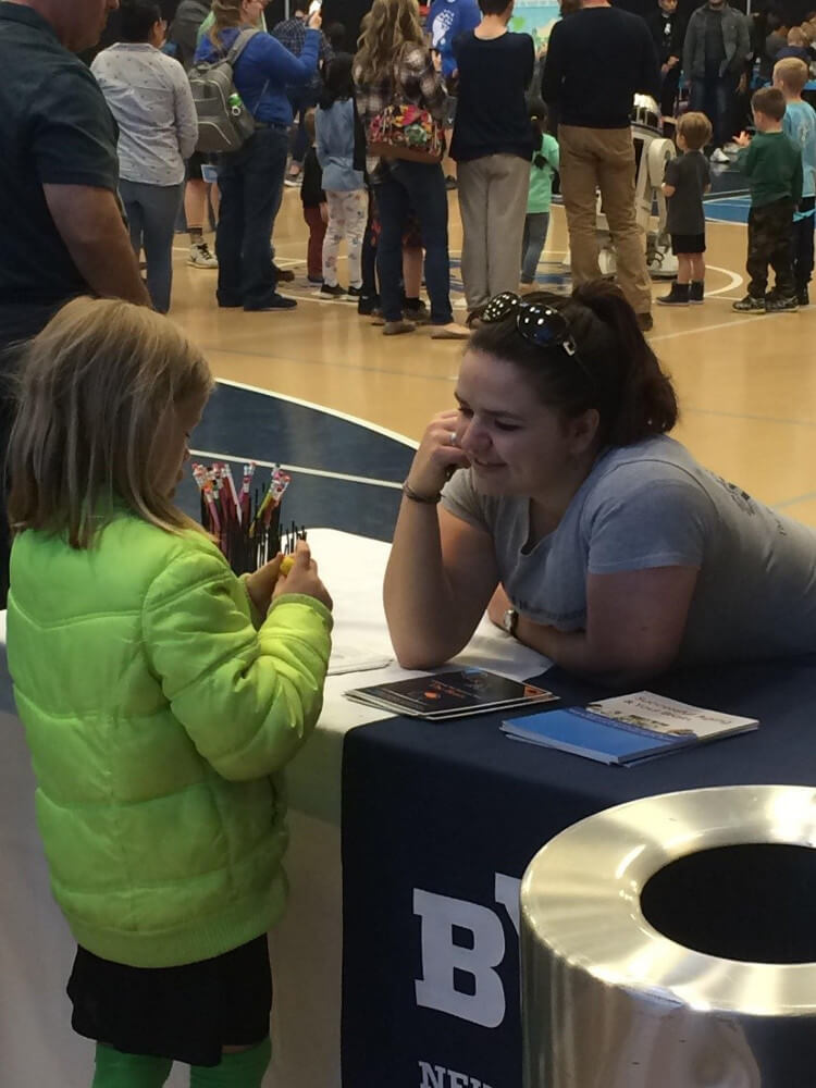 A little girl looks at a brain eraser at an event organized by Brigham Young University in Utah.