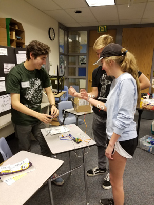 A volunteer works with high school students during an event organized by Colorado State University