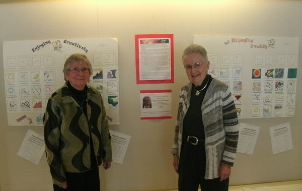 Dr. Shallcross (l) & Dr. Louise E. Loomis (r) viewing the display of Enjoying Your Creativity (various shapes to prompt creative drawing), Duncaster Retirement Community