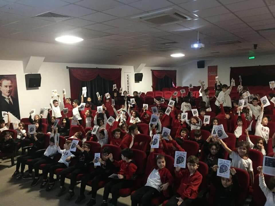 Primary school students holding their booklets after a BAW meeting organized by Eskisehir Osmangazi University (ESOGU) in Turkey.