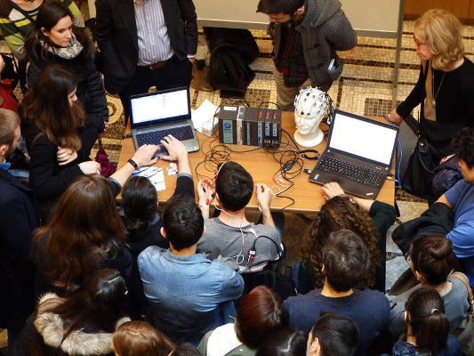 Learning about brain research tools during an event organized by Hafricah.NET in Messina, Italy