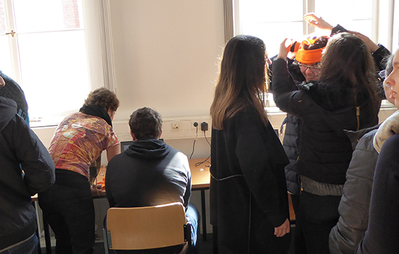 Trying on a brain contraption at Humboldt-Universität zu Berlin in Germany