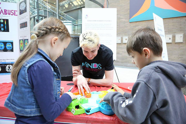 Students play Hungry Hippos and learn about the brain during a brain fair organized by Icahn School of Medicine at Mount Sinai in New York