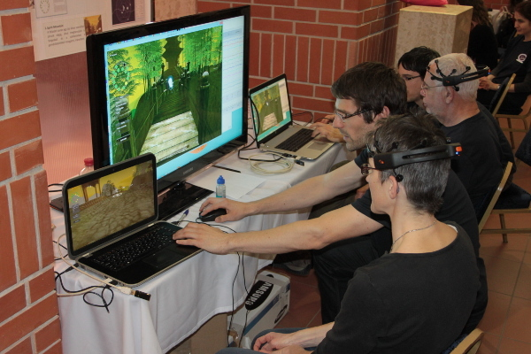 Participants play a brain video game at an event organized by Institute of Experimental Medicine of the Hungarian Academy of Science