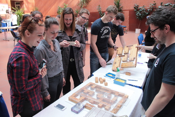 Students look at a mouse complete a maze at the Institute of Experimental Medicine of the Hungarian Academy of Science