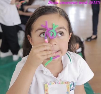 A girl with a pipe cleaner neuron during an event organized by Instituto Nacional de Psiquiatría Ramón de la Fuente Muñiz in Mexico