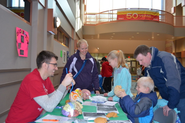 An activities table during an event organized by Iowa State University & Science Center of Iowa