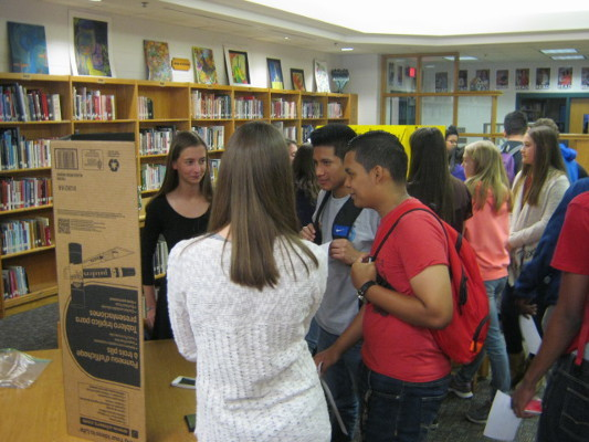 Poster presentations during a BAW Lunch in the Library at James River High School in Virginia