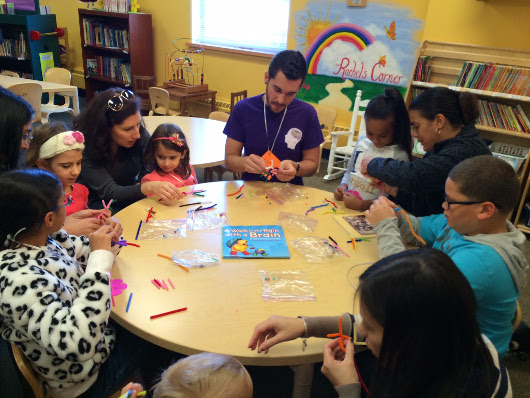 Children learn about the brain and make neurons at an event organized by Lehigh Valley SfN Chapter (Moravian College) in Pennsylvania