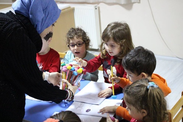 Children choose brain pencils and erasers at Ayla Oktay Elemantary School organized by Marmara University in Turkey