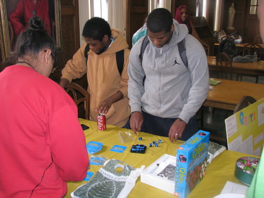 Students play brain games at an event organized by Marygrove College in Michigan