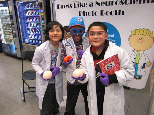 Visitors dressed like neuroscientists at the Michigan State University Brain Awareness Week event. MI, USA