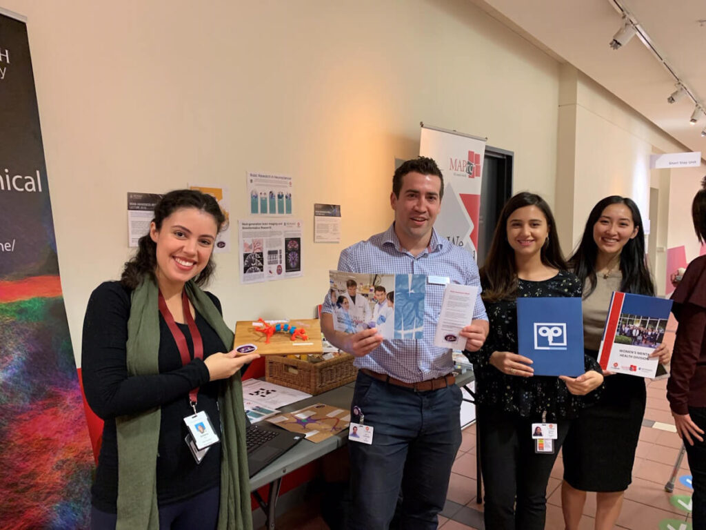 Posing with some brainy materials during an event organized by Monash University in Melbourne, Australia.