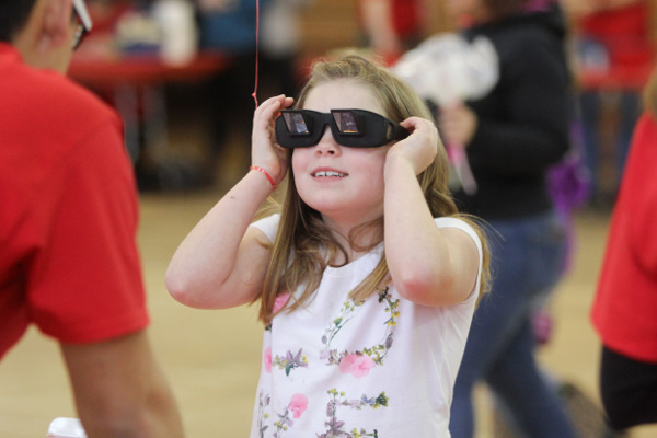 A girl tries out Distortion Goggles at the Investigation Fair organized by Muskingum University in New Concord, Ohio