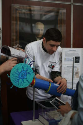 An NYU student teaches about neurons at an event organized by NYU School of Medicine as part of BraiNY in New York
