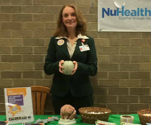 Dr. Schaefer demonstrating the structures of the brain at Nassau University Medical Center's BAW info table in New York