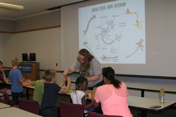Children make their own neurons during an event organized by North Central Florida Society for Neuroscience
