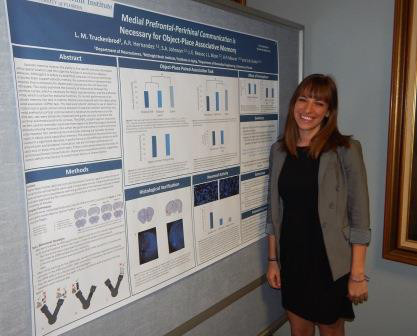 A student presents her research at an event organized by North Central Florida Society for Neuroscience