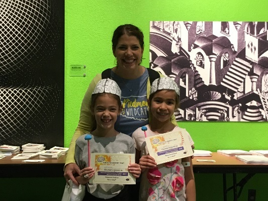 Showing off BAW Participation Certificates at an event at the Science Museum Oklahoma organized by the Oklahoma Neuroscience Chapter