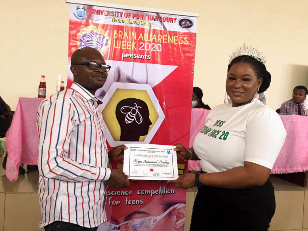 Proudly posing with a certificate of participation for the Brain Bee (a neuroscience competition for teens) organized by the University of Porthacourt and the Youth Neuroscience Organization in Nigeria, Africa.