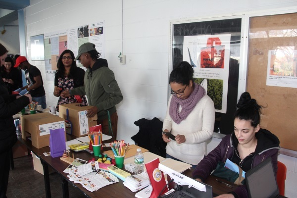 Students participating in activities and exhibits during an event organized by SUNY Old Westbury in New York