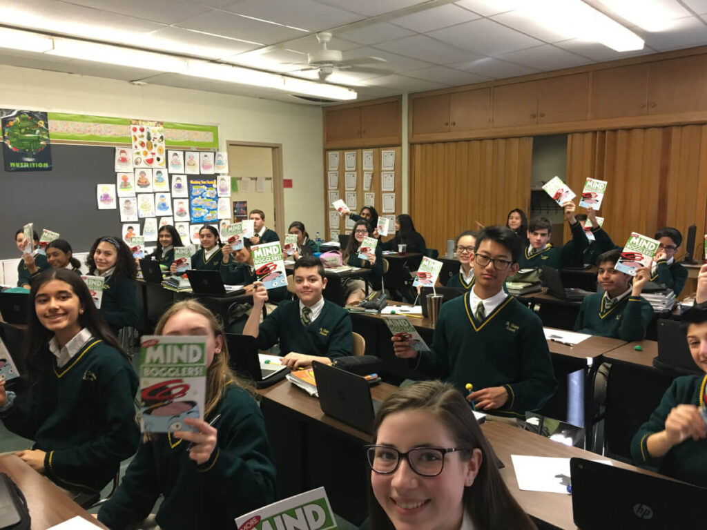 Students hold up some BAW materials at an event organized by Saint Helena School in New Jersey.