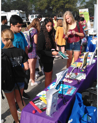 Pineridge High students in front of an brain informationl table organized by the Sia Yorker Brain Awareness Foundation