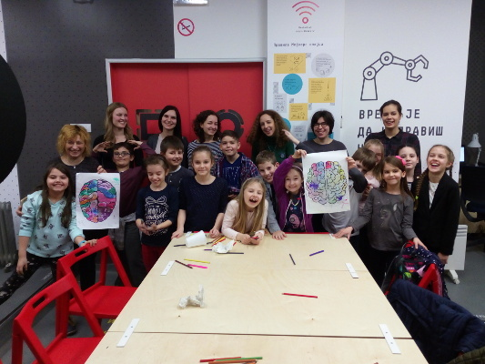 Children participate in an anatomical puzzle workshop during an event organized by Students' Neuroscience Society in Belgrade, Yugoslavia