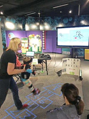 Visitors learn about the mind in motion and are outfitted with motion sensors, demonstrating real-time kinematics, at an event organized by the University of Louisville in Kentucky