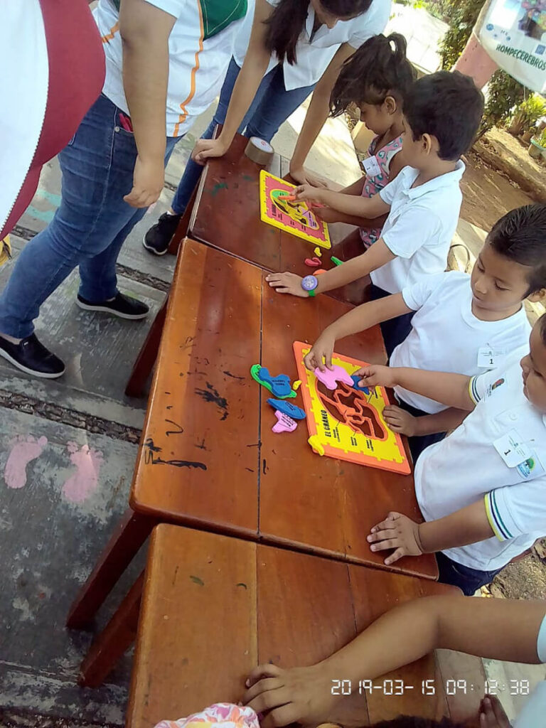 Children trying to complete brain puzzles at an event organized by Universidad de Quintana Roo in Mexico.