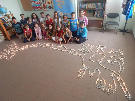 A shiny neuron created by elementary students at school visit organized by University of Patras in Greece