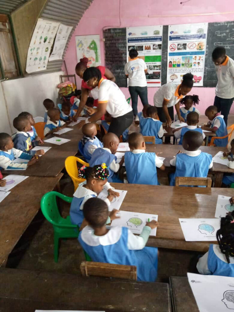 Elementary school children learning to color a diagram of the Brain during an event organized by University of Buea in Cameroon.