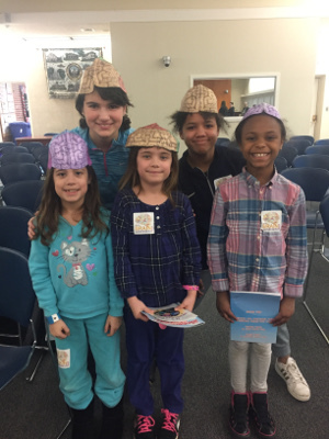 Children wear brain hats during an community event organized by the University of Connecticut