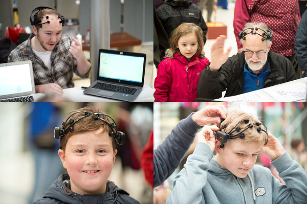 Members of the public try out EEGs during an event organized by the University of Exeter in the United Kingdom