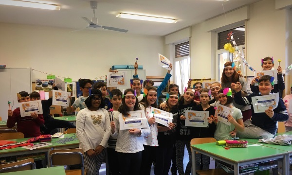 Elementary students hold up BAW Participation Certificates during an event organized by University of Verona in Italy