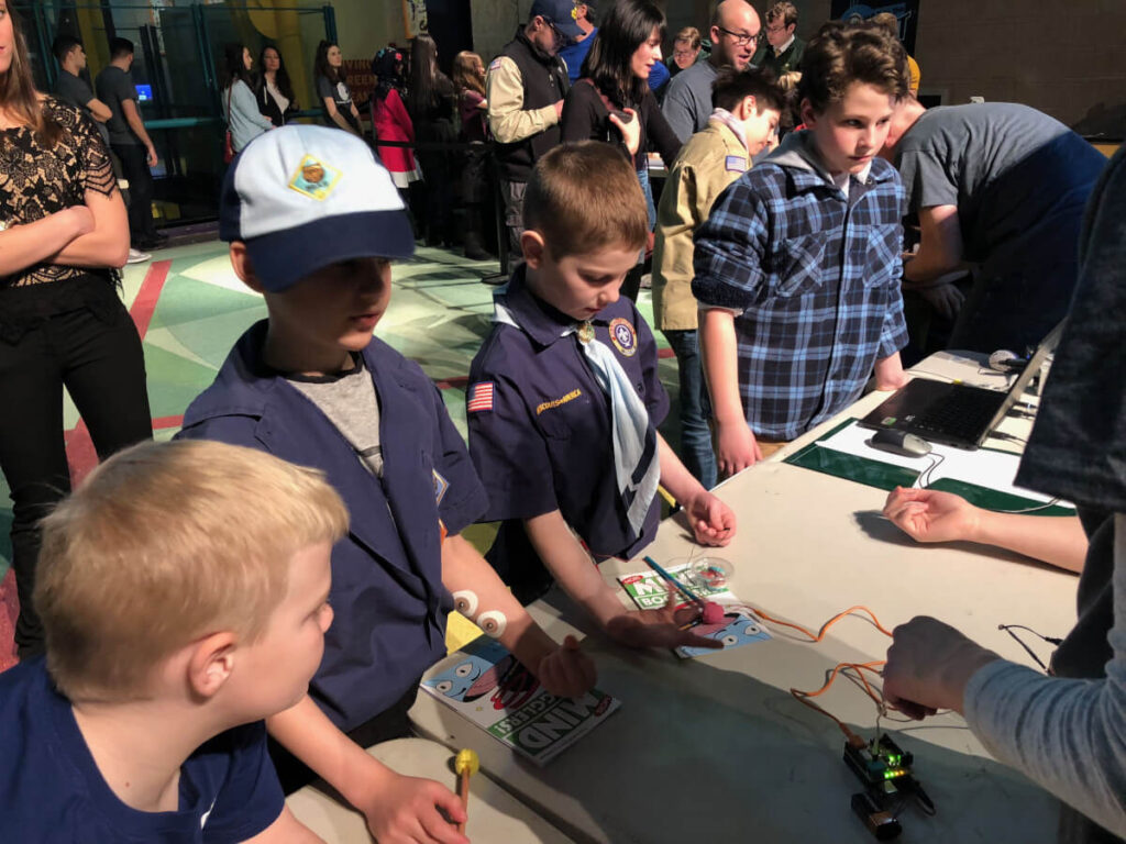 Human-human interface exhibit: electrical recording and stimulation of muscles, part of Brain Day in Detroit organized by Wayne State University in Michigan.