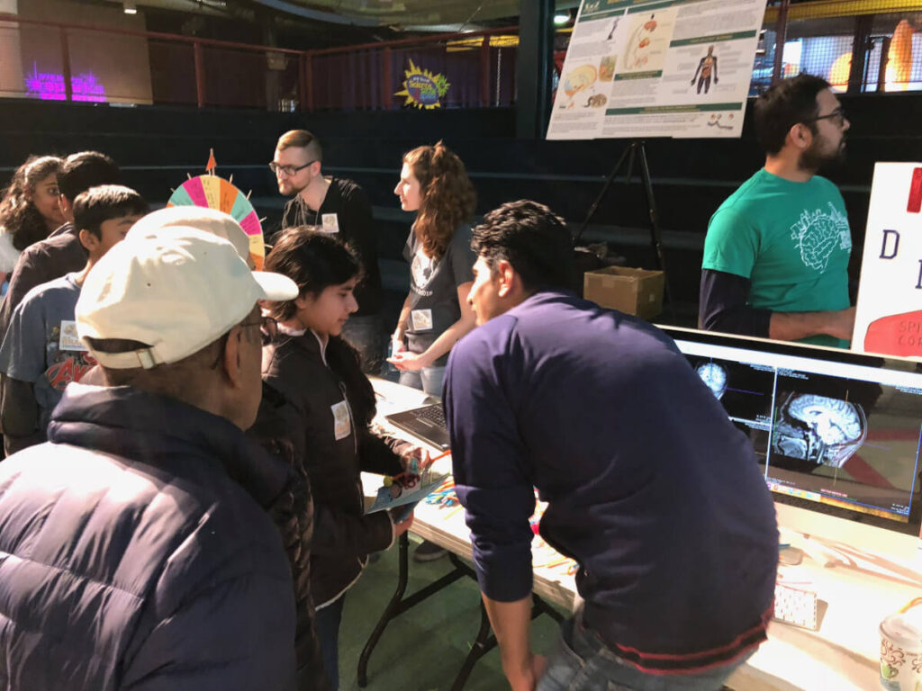 Neurology exhibit: brain images, testing reflexes, part of Brain Day in Detroit organized by Wayne State University in Michigan.
