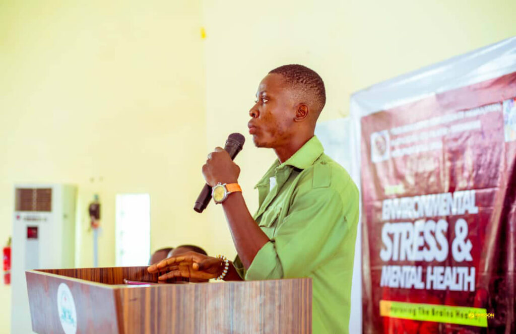 "A speaker at an event on ""Environmental Stress and Mental Health,"" organized by the University of Porthacourt and the Youth Neuroscience Organization Kaduna State in Nigeria, Africa."
