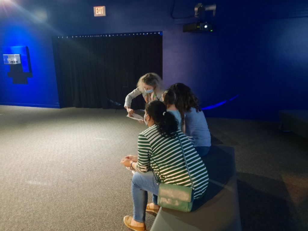 Dr. Christine Gerin speaks with a family about the impact of concussions at an event organized by the International Museum of Art & Science in Texas.