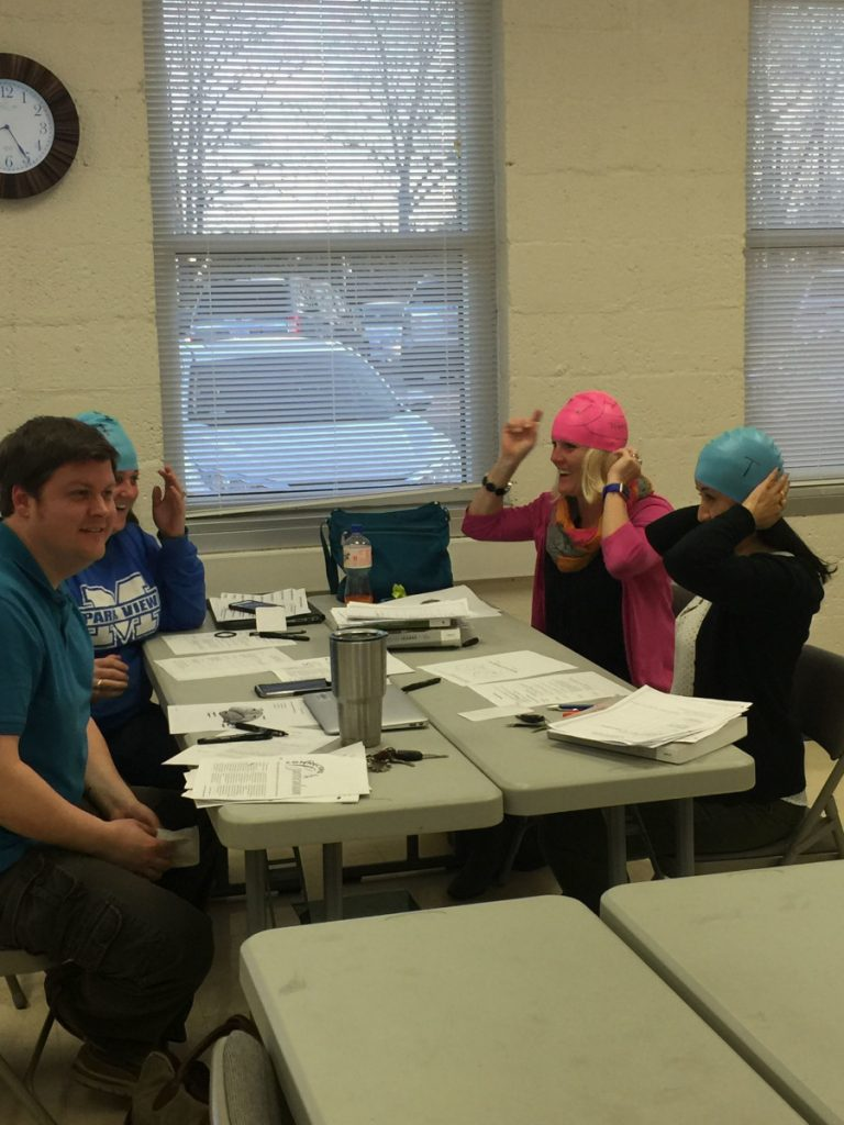 Swim cap brains at an event organized by The University of North Carolina at Charlotte.