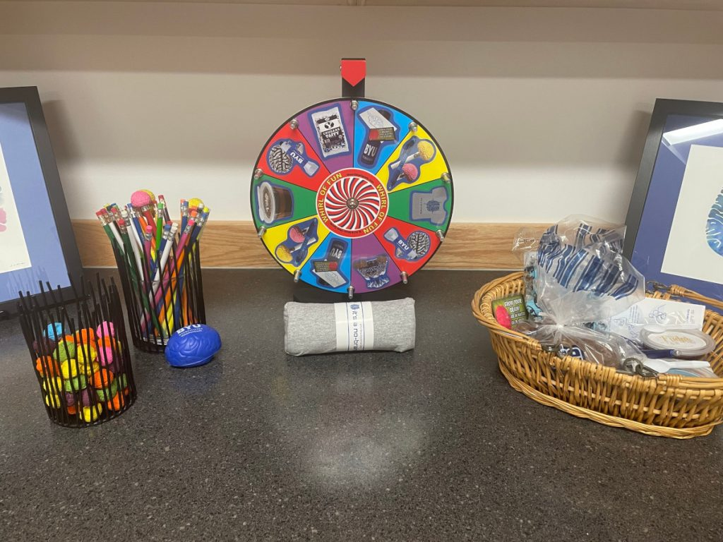 Materials and prize wheel at an event organized by Brigham Young University Neuroscience Center in Utah.