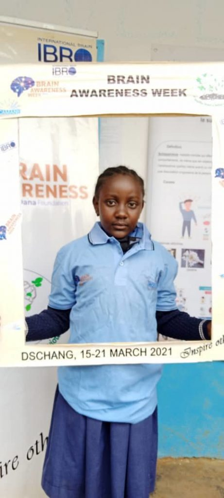 A young girl competition winner poses at an event organized by the Cameroon Association for Neuroscience / University of Dschang in Cameroon.